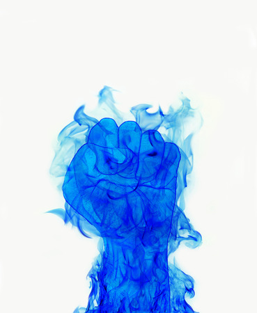blue fire flames fist on white  photo
