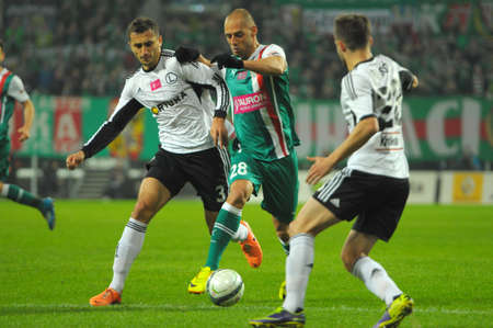 premiership: Wroclaw. POLAND - March 09: Match T-Mobile Ekstraklasa between Wks Slask Wroclaw and Legia Warszawa. Flavio Paxiao in action on  March 09, 2014 in Wroclaw. Poland.