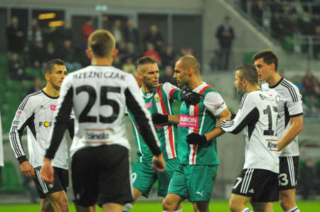 premiership: Wroclaw. POLAND - March 09: Match T-Mobile Ekstraklasa between Wks Slask Wroclaw and Legia Warszawa. Flavio and Marco Paxiao surrounded by Legia players in Wroclaw on March 09, 2014 in Wroclaw. Poland.