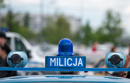 totalitarianism: Polish Milicja (Old Police) sign on a old car Stock Photo