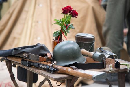 reenaction: world war 2 equipment - rifle, hand grenade uniform and rose