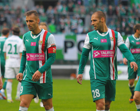 Wroclaw. POLAND - April 12: Match T-Mobile Ekstraklasa between Wks Slask Wroclaw and Lechia Gdansk. Football twins, Flavio and Marco Paxaio on April12, 2014 in Wroclaw. Poland.