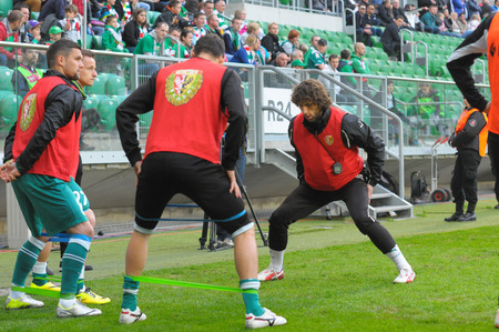 Wroclaw. POLAND - April 12: Match T-Mobile Ekstraklasa between Wks Slask Wroclaw and Lechia Gdansk. Marek Swider warming up players on April12, 2014 in Wroclaw. Poland.
