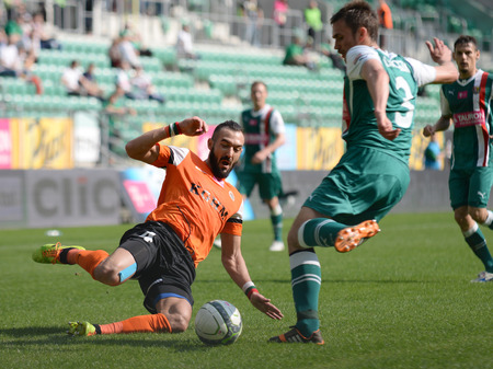 premiership: Wroclaw. POLAND - April 26: Match T-Mobile Ekstraklasa between Wks Slask Wroclaw and Zaglebie Lubin. Widanow Pawel slide tackle on April 26, 2014 in Wroclaw. Poland.