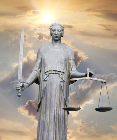 sword act: justice statue with sword and scale Stock Photo