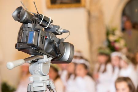 camera recording a communion