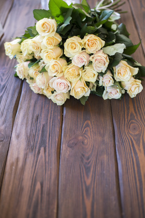 rose bouquet:  rose bouquet lying on a wooden table