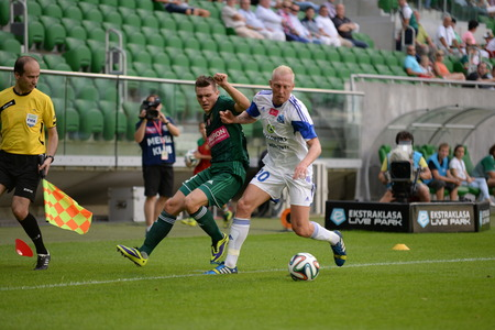 ruch: Wroclaw  POLAND - July 20  Match T-Mobile Ekstraklasa between Wks Slask Wroclaw and Ruch Chorzow  Marek Szyndrowski fighting for ball on July 20, 2014 in Wroclaw  Poland
