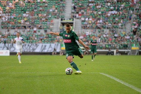 ruch: Wroclaw  POLAND - July 20  Match T-Mobile Ekstraklasa between Wks Slask Wroclaw and Ruch Chorzow  Cross ball by Robert Pich on July 20, 2014 in Wroclaw  Poland  Editorial