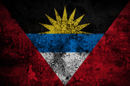 disintegrate: grunge flag of Antigua and Barbuda with capital in St. Johns