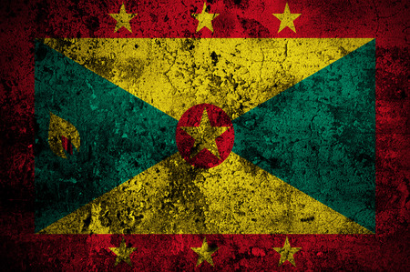 disintegrate: grunge flag of Grenada with capital in St. Georges