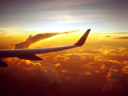 Wing of an airplane in the sunset Stock Photo