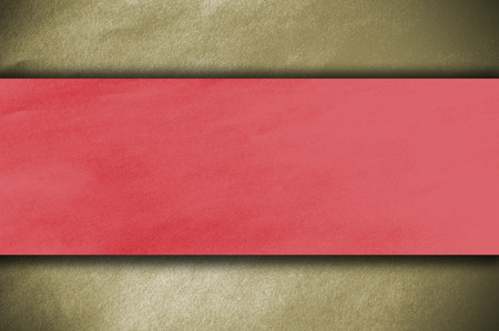 ripped metal: red paper on golden wall
