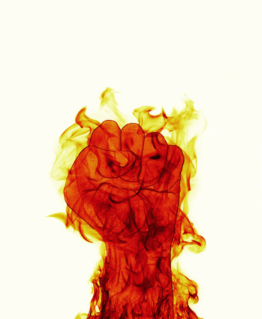 inferno: inferno Fire fist on white background Stock Photo