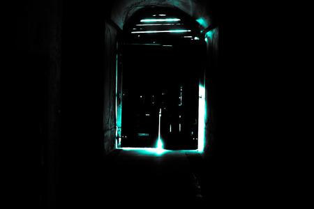 Mysterious door, secret entrance or exit blue light