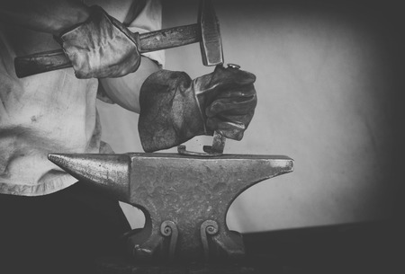 vintage photo Detail shot of metal being worked at a blacksmith forge