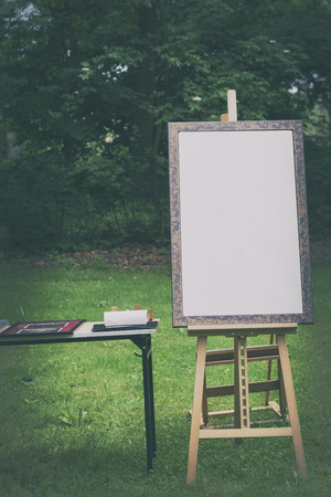 blank canvas: blank canvas rests on a easel, retro stylized