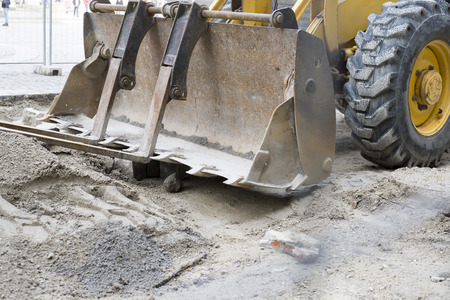 echnology: close up on construction vehicle in sand