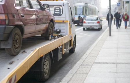 roadside assistance: Roadside assistance car towing truck in the city Stock Photo