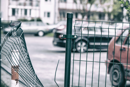 Wire fence at guarded parking broke by thief photo