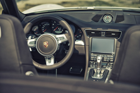carrera: Sleza, Poland, August 15, 2015: Close up on Porsche 911 carrera s car steering wheel and cockpit  Motorclassic show on August 15, 2015 in the Poland