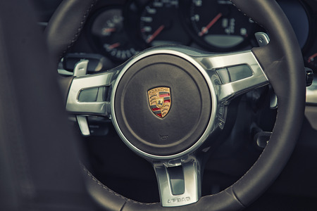 california delta: Sleza, Poland, August 15, 2015: Close up on Porsche 911 carrera s car steering wheel and cockpit  Motorclassic show on August 15, 2015 in the Poland