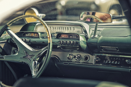 car dashboard: Sleza, Poland, August 15, 2015: Close up on old vintage car steering wheel and cockpit on  Motorclassic show on August 15, 2015 in the Poland