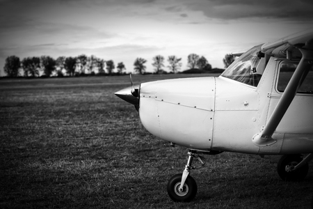 airplane ultralight: small plane on aiport field, black and white Stock Photo