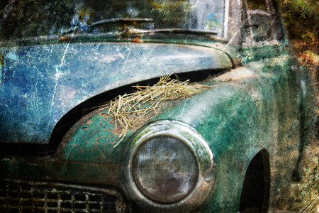 corrosion: Old Car rusting in forest, damage color vintage photo effect