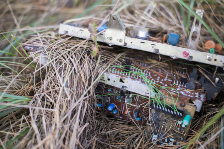 kinescope: Electronic waste  on grass