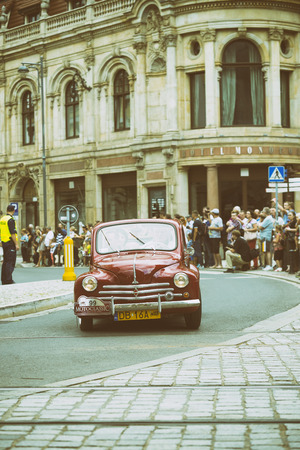 Wroclaw- August 18: Old red car on Motoclassic show on vintage effect  in Wroclaw, Poland on August 18, 2014.