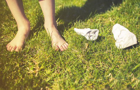 leis: socks on green grass with human feet