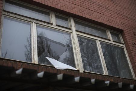 broken glass window: broken glass window reflecting clounding sky