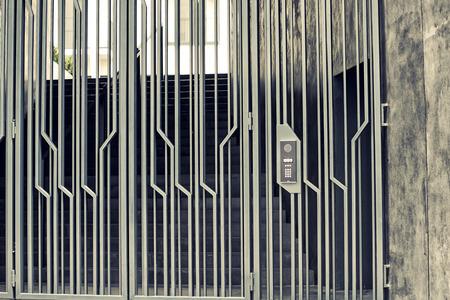 intercom: Close-up of building intercom and gate