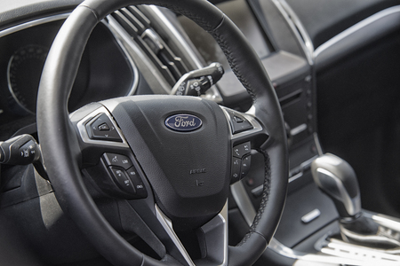 sterring: Wroclaw, Poland, May 28, 2016: Close up on Ford C-Max sterring wheel on Motoshow on May 28, 2016 in Poland