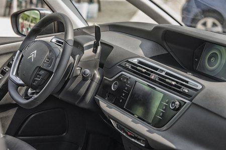 sterring: Wroclaw, Poland, May 28, 2016: Close up on Citroen C4 Picasso sterring wheel on Motoshow on May 28, 2016 in Poland