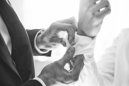 french cuffs: elegant young man getting ready for wedding Stock Photo