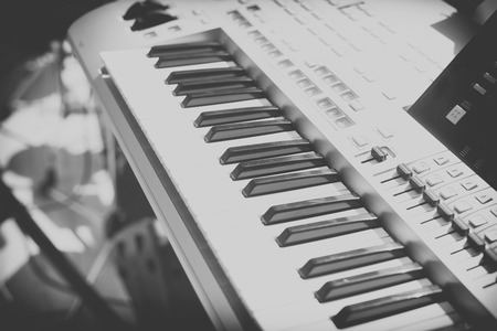 acoustically: Vintage looking Detail of black and white keys on music keyboard