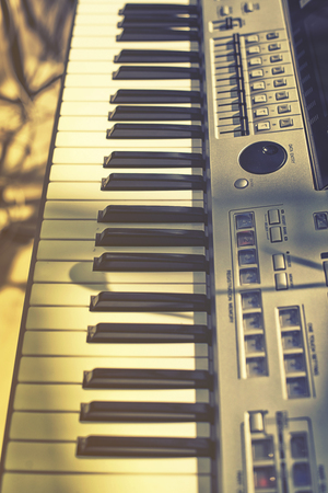 acoustically: Vintage looking Detail of  keys on music keyboard Stock Photo