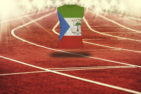equatorial: red running track with lines and Equatorial Guinea  flag on shirt Stock Photo