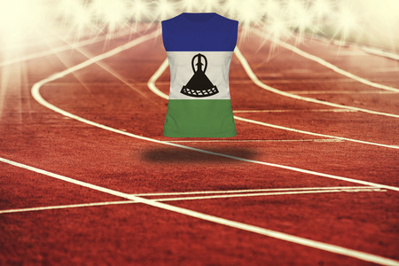 lesotho: red running track with lines and Lesotho flag on shirt Stock Photo