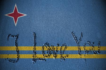 aruba flag: I love you written on sand with blending  Aruba flag