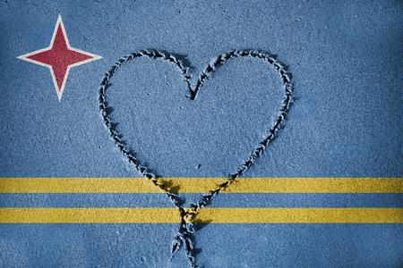 aruba flag: heart shape drawning on sand with blending  Aruba flag Stock Photo