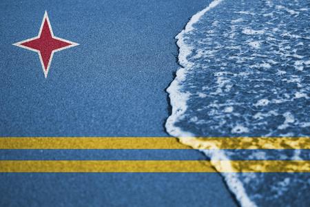 aruba flag: Sand and sea  wave background or texture with blending  Aruba flag