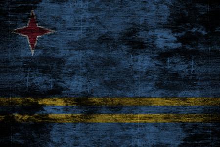 aruba flag: dark grunge wood background or texture with blending  Aruba flag