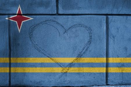 aruba flag: Love heart sing on wall with blending  Aruba flag Stock Photo
