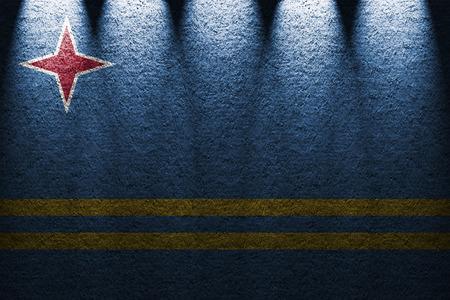 aruba flag: dark wall five lights background with blending  Aruba flag Stock Photo