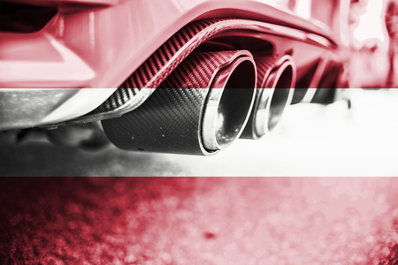 combustible: pollution of environment by combustible gas of a car with blending Austria flag