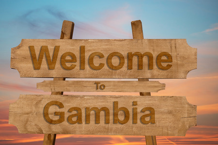 Welcome to Gambia sing on wood background Stock Photo
