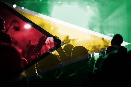 blending: live music concert with blending Guyana flag on fans Stock Photo